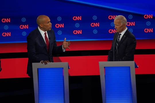 Democratic presidential candidates Sen. Cory Booker and former Vice President Joe Biden at a Democratic presidential debates in Detroit on July 31, 2019.