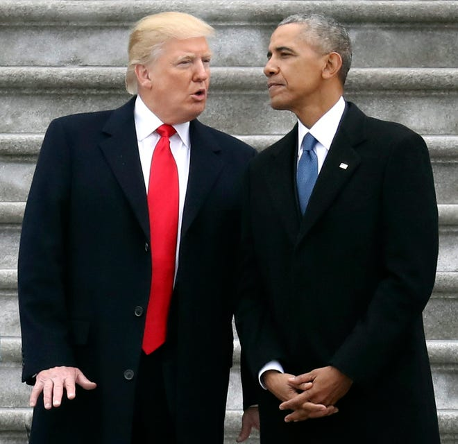 President Donald Trump talks with former President Barack Obama on Capitol Hill in Washington, prior to Obama's departure to Andrews Air Force Base, Maryland on Jan. 20, 2017.