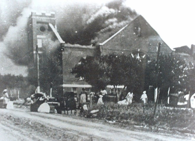 Mt. Zion Baptist Church in the Greenwood district of Tulsa after it was set afire by a white mob in 1921.