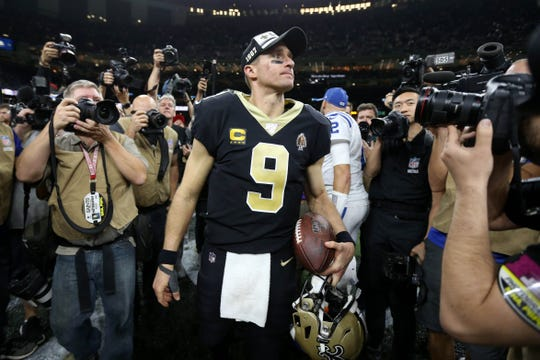 New Orleans Saints quarterback Drew Brees (9) on the field after their game against the Indianapolis Colts at the Mercedes-Benz Superdome.