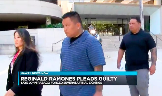 This undated photo from video provided by Hawaii News Now shows ex-Honolulu police officer John Rabago outside federal court in Honolulu.