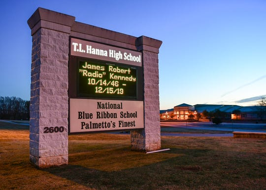 "The T.L. Hanna High School sign flashes memory of James ""Radio"" Kennedy 10/14/46 - 12/15/19. Friday from 5 p.m. to. 8 p.m. is a visitation at the school."