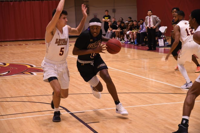 Jordan Adebutu (0) drives against a Loyola defender during Tuesday's game against Loyola.