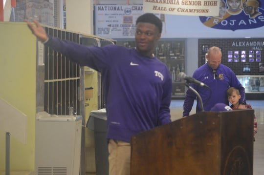 "ASH defensive back Jadarius ""Bud"" Clark  (left) talks on the podium and thanks his family before signing with TCU Wednesday."