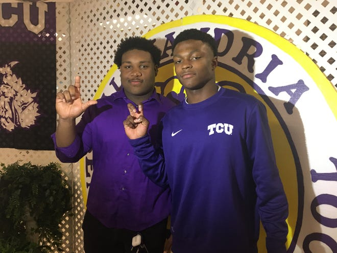 "ASH seniors Jacobian Guillory (left) and Jadarius ""Bud"" Clark"" represent their new schools' hand signs Wednesday during National Signing Day Wednesday. Guillotry signed with LSU, while Clark signed with TCU."