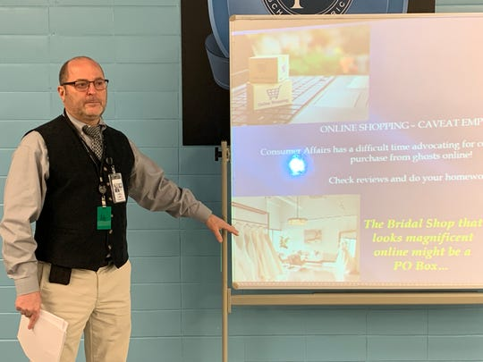 David Salkin, director of the Monmouth County Division of Consumer Affairs, talks to a class at Asbury Park High School.