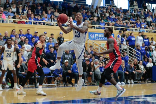 Seton Hall Pirates guard Shavar Reynolds (33) drives to the basket against the Stony Brook Seawolves at Walsh Gym last month. Note the old wooden seats in the balcony.