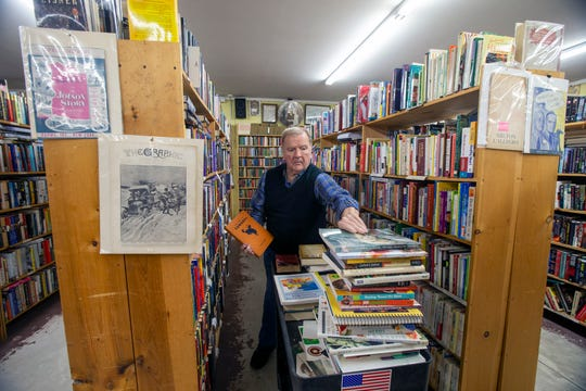 George Engle, owner of Book Garden, a used bookstore in the Cream Ridge section of Upper Freehold that's celebrating its 30th anniversary in business this year, arranges books at Book Garden in Cream Ridge, NJ Wednesday, December 18, 2019.