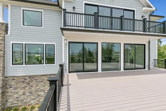 The back of the home offers a huge terrace and patios.