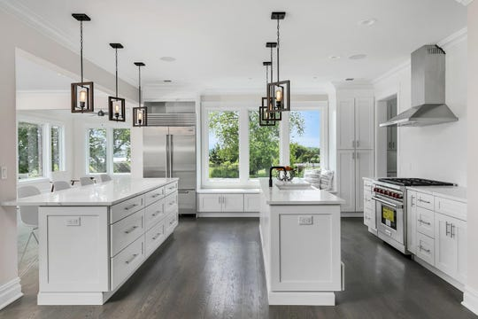 The kitchen features a center Island, Eat-In, Breakfast nook with quartz stone.