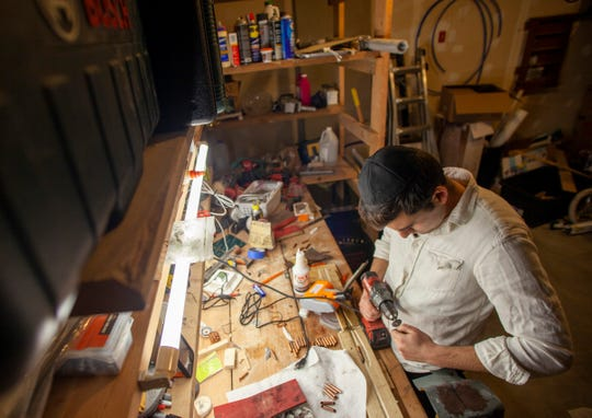 Leib Wolf's garage becomes a shop where he cuts, drills, glues and polishes the copper pipes he turns into menorahs each year. He began crafting menorahs right after getting married thinking it could be a good endeavor to take on.