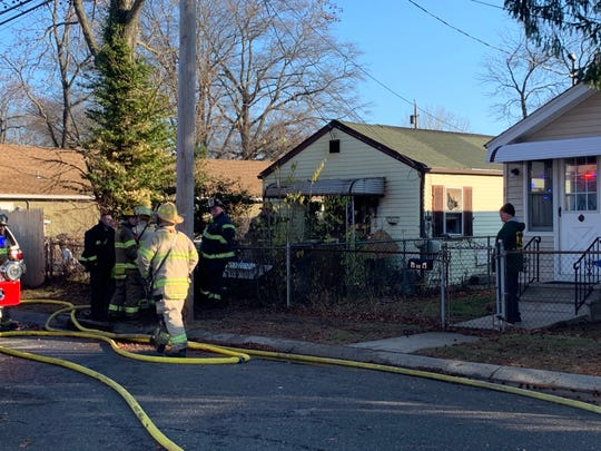 Fire fighters respond to a fire at 160 Morningside Ave., in Middletown on Dec. 18, 2019