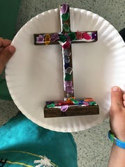A multi-colored cross is a gift made at Wylie UMC's Christmas gift project.