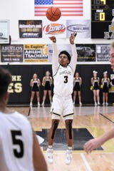 Abilene High's Jalen McGee (3) takes a 3-pointer against Wylie at Eagle Gym. Now a junior, McGee is helping lead the Eagles resurgence with 14.5 points and five assists per game as they finish the first half of district play on Tuesday against Euless Trinity.