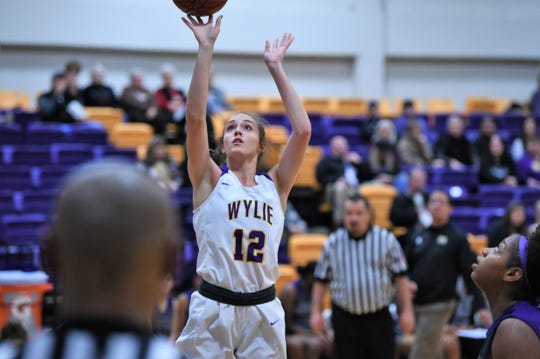 Wylie's Karis Christian (12) puts up a shot against Midland High at Bulldog Gym on Tuesday. Christian scored a game-high 13 points, but Wylie dropped the 43-39 contest.