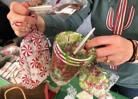 Packing gifts for Christmas giving at Wylie UMC.