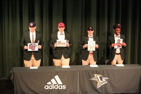 Four Christ School football players signed letters of intent on Dec. 18 to play college football