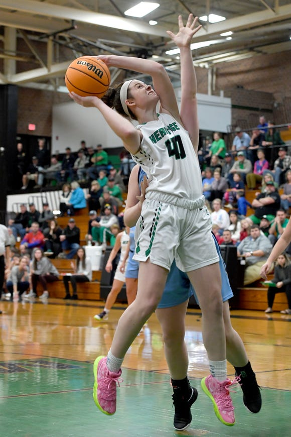 Mountain Heritage's Kylie Robinson goes up for a shot against Watauga during their game at Mountain Heritage High School on Dec. 17, 2019.