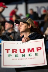 """On the day the House of Representatives votes on articles of impeachment, Jaime Nemire from Battle Creek attends Donald Trump's """"Merry Christmas"""" rally on Wednesday, Dec. 18, 2019 at the Kellogg Arena in downtown Battle Creek, Mich. The rally is a campaign stop for the 2020 election."""