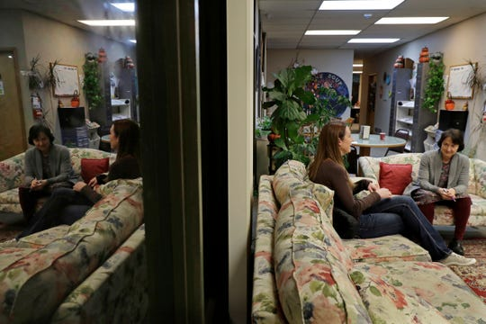 In this Nov. 14, 2019 photo, Jamie Cline, second from right, talks with Dr. Lucinda Grande, right, medical director of the Olympia Bupe Clinic at the Capital Recovery Center in Olympia.