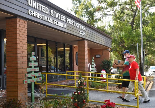 Russ and Raylene Coe of Mims visit the community's U.S. Post Office, which gets them the postmark of Christmas.  Christmas, Florida is located along State Road 50 (Colonial Drive) between Orlando and Titusville.