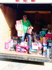 Jesse Zermeno prepares for upcoming Christmas giveaway at the Operation Hope headquarters in Fellsmere.