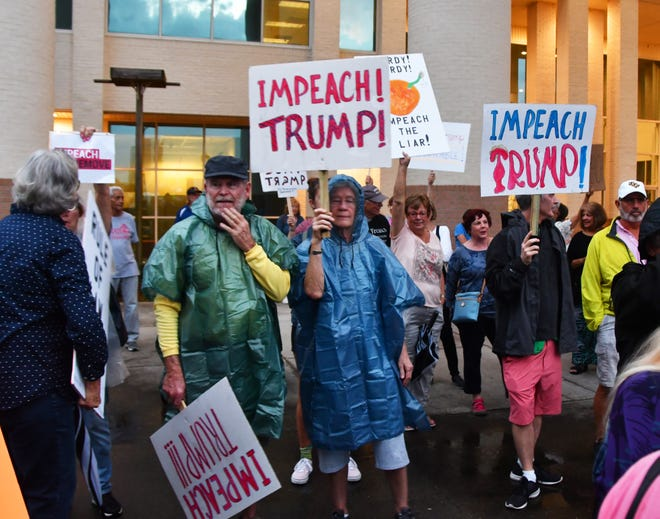 Hundreds gathered outside the Government Center in Viera Tuesday night as part of a National Day of Action organized by MoveOn.org and other groups to demand Rep. Bill Posey vote for impeachment. A smaller but vocal group showed up in support of Trump.