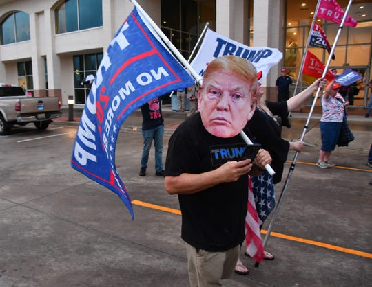 Hundreds gathered outside the Government Center in Viera Tuesday night as part of a National Day of Action organized by MoveOn.org and other groups to demand Congressman Posey vote for impeachment. A smaller, but vocal group of Trump supporters showed up in support of Trump.