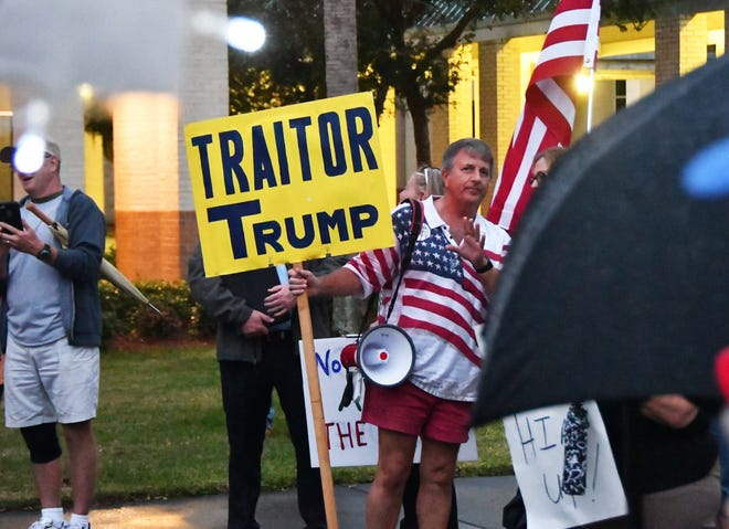 Hundreds gathered outside the Government Center in Viera Dec. 17 as part of a National Day of Action organized by MoveOn.org and other groups, to demand that Rep. Bill Posey vote for impeachment. A smaller but vocal group of Trump supporters showed up in support of Trump.