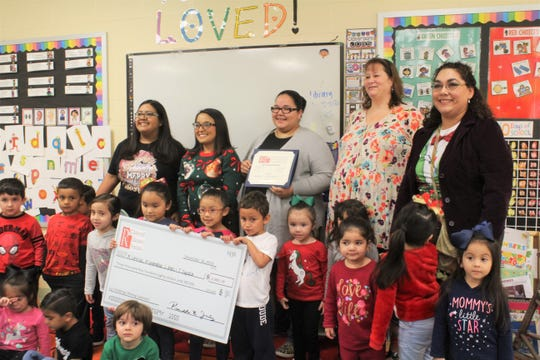 Lotspeich Elementary pre-K teachers and students pose with a giant check for almost $3,500, awarded by the Robstown ISD Education Foundation, on Tuesday, Dec. 17, 2019. From the left are teachers Melinda Cortinas, Amanda Covarrubias, Tracey Zapata and Cori Jones, with Principal Angel Lopez.
