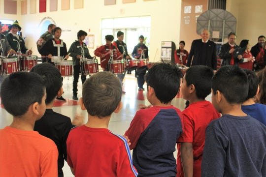Lotspeich Elementary students watch the Robstown Early College High School drumline, which joined district officials to surprise teachers with grants on Tuesday, Dec. 17, 2019.