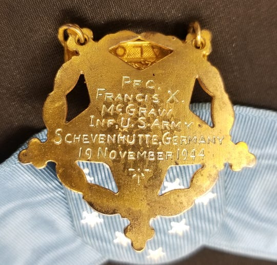 PFC. Francis X. McGraw's inscription appears on the reverse side of his Medal of Honor for heroic action in Germany in 1944 during World War II. President Harry Truman posthumously awarded the Camden, N.J., infantry soldier the medal a year later.