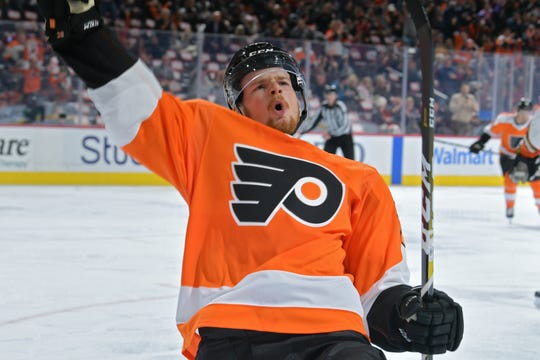 PHILADELPHIA, PA - DECEMBER 17: David Kase #72 of the Philadelphia Flyers celebrates his first NHL goal during the game against the Anaheim Ducks in the second period at Wells Fargo Center on December 17, 2019 in Philadelphia, Pennsylvania. (Photo by Drew Hallowell/Getty Images)