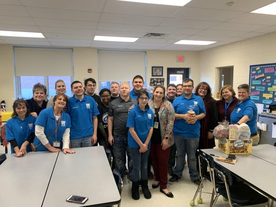 Courier Post reporter Carly Q. Romalino poses with Williamstown High School's Occupational Transitions Program students, winners of the Courier Post's 2019 Charitable Challenge.