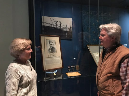 Sue Heindel of Haddonfield and brother  Steve McGraw of New York  City visit the new Medal of Honor exhibit for their  uncle, Francis X. McGraw of Camden, N.J., at the National Museum of American History at the Smithsonian Institution in Washington, D.C.
