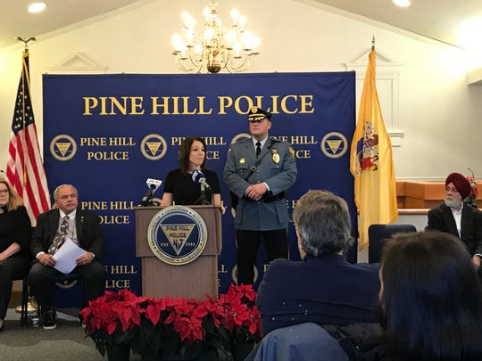 Amanda Leese of Volunteers of America Delaware Valley talks about a new partnership with Pine Hill Police, as Chief Chris Winters listens.