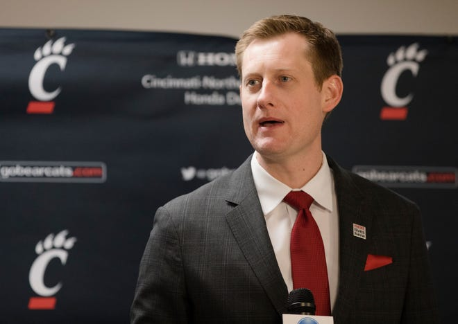 John Cunningham, UC Athletic director, speaks at his first press conference as University of Cincinnati's Athletic Director on Wednesday, Dec. 18, 2019, at Fifth Third Arena at the University of Cincinnati in Cincinnati.