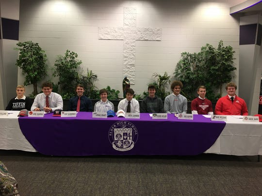 Elder High School athletes signing their letters of intent Dec. 18 are, from left: Jack Collins, Tiffin wrestling; Luke Kandra, Louisville football; Kory Klingenbeck, Walters State baseball; Lukas Kraft, Thomas More golf; Seth Lambers, Campbell wrestling; Cooper Mullen, Ohio University cross country; Joe Royer, Ohio State football; Zack Williams, Indianapolis baseball; Jakob James, Ohio State football.