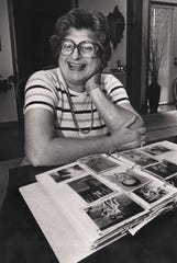 AUGUST 22, 1982: Natalie Guttman, the paternal aunt of Steven Spielberg, with a family photo album in her Greater Cincinnati home.