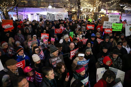 Activists gather to rally in support of the impeachment and removal of President Donald Trump, Tuesday, Dec. 17, 2019, at Fountain Square in Cincinnati.