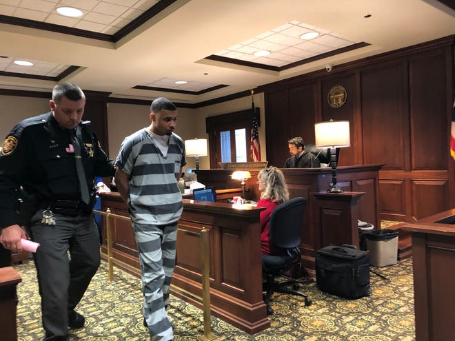 Ibin Freeman is led out of a courtroom Wednesday, Dec. 18, 2019, after being sentenced to 9 1/2 years in prison for robbing a car full of teens in Madisonville in March then fleeing police and crashing into a police vehicle. Hamilton County Common Pleas Judge Thomas Beridon imposed the sentence.
