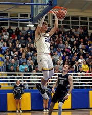 CNE forward Skyler Schmidt has a breakaway dunk in the game between the Blanchester Wildcats and the CNE Rockets at CNE High School December 17, 2019. CNE defeated Blanchester 73-58.
