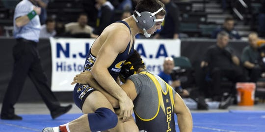 John Poznanski, left, wrestles in the NJSIAA Tournament two years ago.