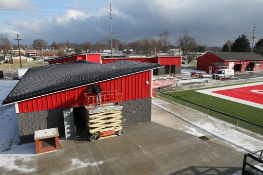 Ted Skeens of Johnson Plumbing and Heating works on the new field house being built at Coshocton High School's Stewart Field.