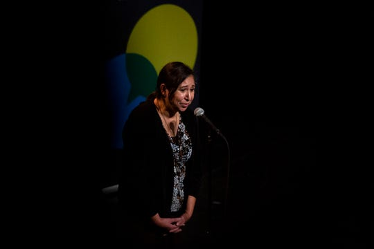 Elizabeth Balcarcel tells her story, Converging Christmases, during the Des Moines Storytellers Project Holiday Spectacular on Dec. 17 at Hoyt Sherman Place in Des Moines.