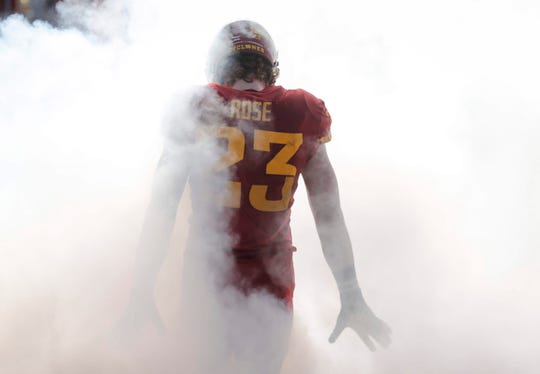 Iowa State sophomore linebacker Mike Rose steps through the fog as the Cyclones take the field prior to kickoff against Kansas on Saturday, Nov. 23, 2019, at Jack Trice Stadium in Ames.