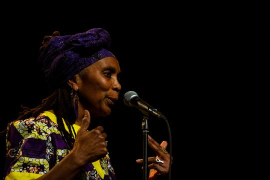 Cynthia Hunafa tells her story about celebrating Kwanzaa during the Des Moines Storytellers Project's Holiday Spectacular event on Tuesday, Dec. 17, 2019, at Hoyt Sherman Place in Des Moines.