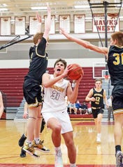 Ankeny sophomore Ryan Crandall (31) splits the defense as the Southeast Polk Rams compete against the Ankeny Hawks in high school boys' basketball on Tuesday, Dec. 17, 2019, at Ankeny High School. Ankeny won 75-62.