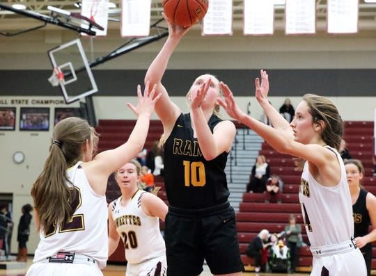 Southeast Polk junior Grace Larkins (10) shoots for two as the Southeast Polk Rams compete against the Ankeny Hawkettes in high school girls basketball on Dec. 17 at Ankeny High School. Southeast Polk won 74-61.