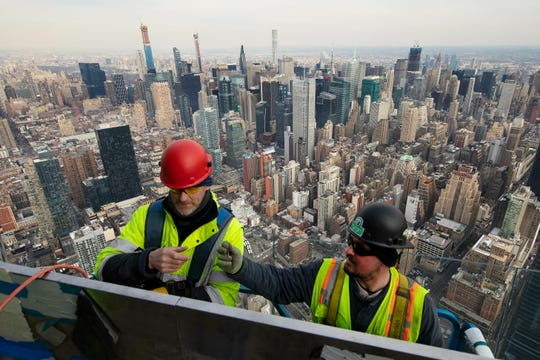 Job growth will be key in 2020 to help the economy avoid a recession. File photo:  In this March 8, 2019, work continues on an outdoor observation deck on the 30 Hudson Yards office building in New York. Business economists expect U.S. economic growth to slow next year, but they say the economy will avoid recession. (AP Photo/Mark Lennihan, File)